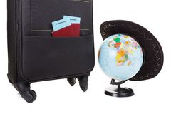 Suitcase with hat on it isolated against a white Stock Photography