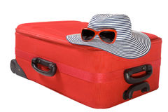 Suitcase and hat isolated on white. Red large suitcase and summer hat isolated on white Royalty Free Stock Photos