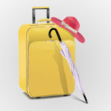 Suitcase with hat and umbrella Royalty Free Stock Photography