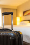 Suitcase in hotel room Stock Images