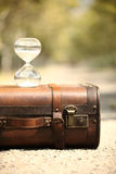 Suitcase and hourglass  with blur background. Travel countdown. vacation countdown Royalty Free Stock Photo