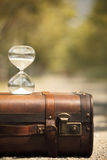 Suitcase and hourglass  with blur background. Travel countdown. vacation countdown Royalty Free Stock Photography