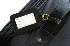 Suitcase label. Black leather label on a black suitcase Royalty Free Stock Images