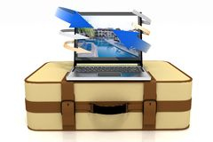 Suitcase and laptop on a white Royalty Free Stock Images