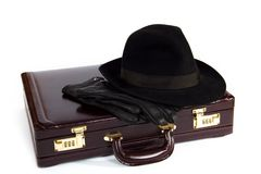 Suitcase with laying from above a hat and gloves Royalty Free Stock Photos
