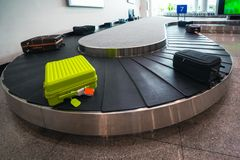 Suitcase or luggage is conveyed through the conveyor belt royalty free stock photos