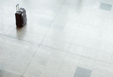 Suitcase with luggage on a floor at the airport Royalty Free Stock Images