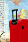Suitcase or luggage, map and globe for travel stock photos