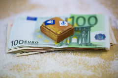 Suitcase lying on banknotes, holiday, holiday allowance, travel Stock Image