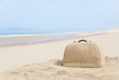 Suitcase made out of sand on beach. Suitcase on remote beach made out of sand. There is loads of space for your writing Stock Photo