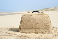 Suitcase made out of sand on beach. Suitcase on remote beach made out of sand. There is loads of space for your writing on the baggage Royalty Free Stock Photo