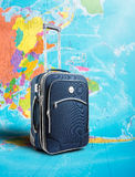 Suitcase on the map Stock Photography