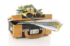Suitcase with maps for travel destinations Royalty Free Stock Photo