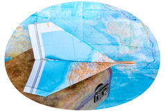Suitcase and maps on white background royalty free stock images
