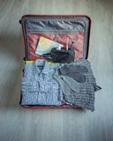 Suitcase with menswear. Still life of mens Stock Image