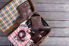 Suitcase with menswear. Suitcase of tourist Stock Photos