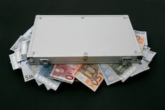 Suitcase Money. Isolated Suitcase Money in a black background royalty free stock photography
