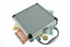 Suitcase with money Stock Images
