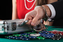 Suitcase with money on casino table Stock Photo