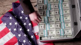 Suitcase, money and US flag. stock video