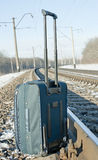 Suitcase near tracks. Suitcase near the railroad tracks Royalty Free Stock Photo