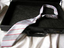 Suitcase with necktie Stock Photos