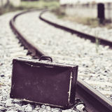 Suitcase next to the railroad tracks Stock Image