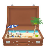 Suitcase open with sea and beach scene in side Stock Photo