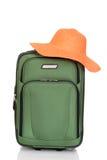 Suitcase with orange beach hat Stock Photos