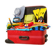 Suitcase Packed to Vacation, Open Red Luggage Full of Clothes royalty free stock photos