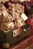 Suitcase with a paper. The ancient suitcase filled by a paper Royalty Free Stock Image