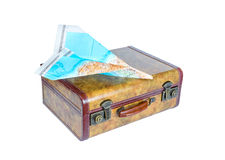 Suitcase and paper airplane on white background royalty free stock image