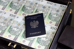 Suitcase passport and polish money corruption concept Royalty Free Stock Image