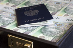 Suitcase passport and polish money corruption concept Royalty Free Stock Photos