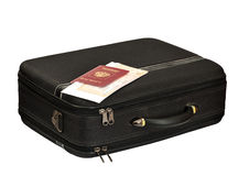Suitcase with the passport and tickets Royalty Free Stock Images