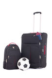 Suitcase with passports, backpack and soccer ball isolated on wh Stock Image