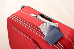 Suitcase, passports and money Royalty Free Stock Photos