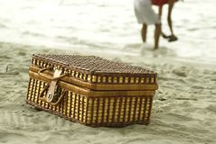 Suitcase and person on beach Stock Photo