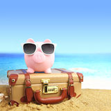 Suitcase with piggy bank Royalty Free Stock Image