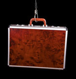 Suitcase from pinned open handcuffs Royalty Free Stock Photos