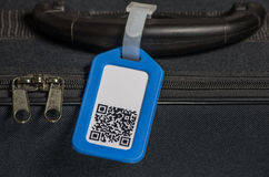 Suitcase with qr code on label Royalty Free Stock Image