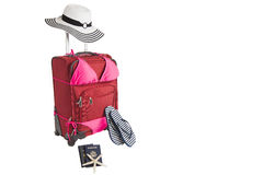 Suitcase Ready For A Beach Vacation. Picture of Red Suitcase In Pink Bikini Bathing Suit Ready for Travel To Beach Vacation With Sandals, Passport and Flip Flops Royalty Free Stock Images