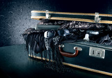 A suitcase ready for vacation. A suitcase packed with party dresses Stock Images