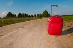 Suitcase on road Royalty Free Stock Image