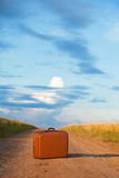 Suitcase at road Royalty Free Stock Photography