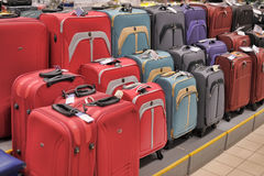 Suitcase Sale. Rack with suitcases in supermarket Royalty Free Stock Images