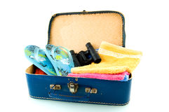Suitcase with sandals, field-glasses and towels. Isolated on white background stock photo