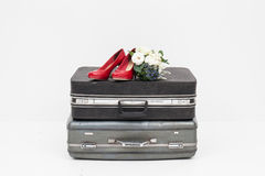 Suitcase with shoes, and flower ready for travel Stock Image