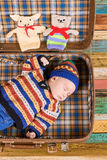 Suitcase with sleeping baby. Royalty Free Stock Images