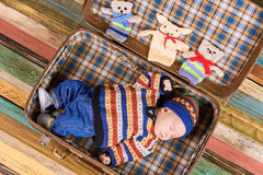Suitcase with a sleeping baby. Royalty Free Stock Photography